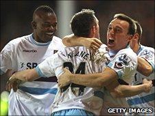 West Ham players celebrate Robbie Keane's goal