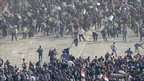 Supporters and opponents of Egyptian President Hosni Mubarak clash in Cairo's Tahrir Square - 2 February 2011