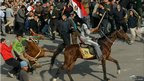 A pro-Mubarak protester is dragged from his horse in Cairo. Photo: 2 February 2011
