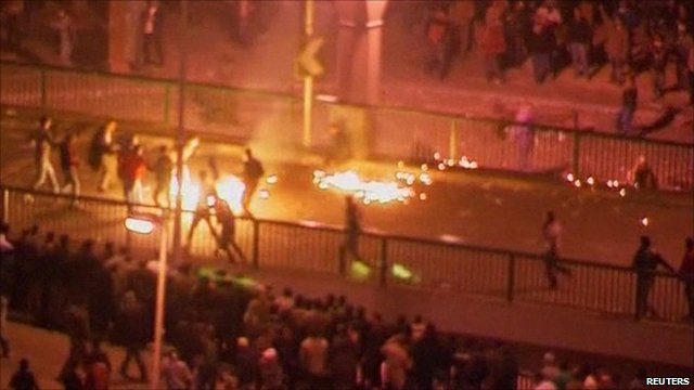 Fire and protesters in Tahrir Square