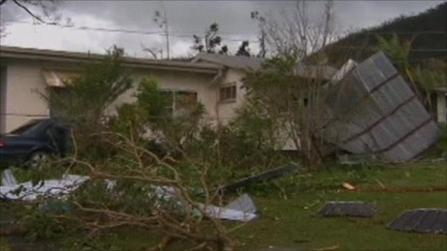 House with part of it's roof blown off