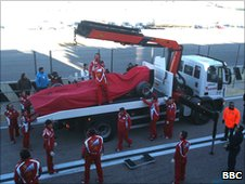 Felipe Massa's car is lifted away after a spin