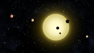 Artist's conception of Kepler-11 system (Nasa/T Pyle)