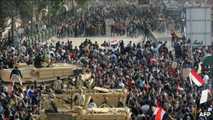 Anti-government demonstrators (top) face pro-regime opponents in Tahrir Square, 2 February