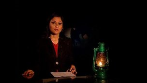 Kantipur TV bulletin presented by kerosene (paraffin) lantern