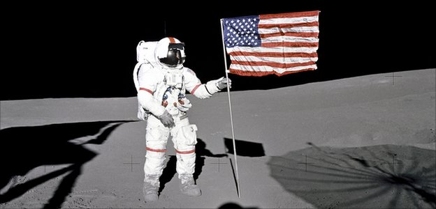 Alan Shepard plants a flag on the Moon