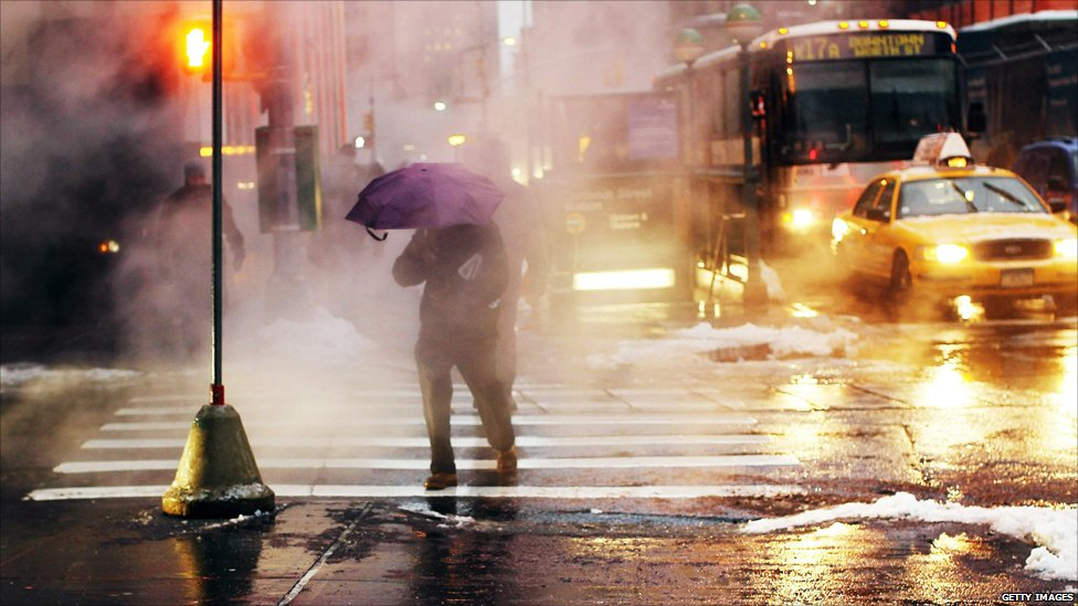 A commuter pushes through freezing rain in New York City on 2 February