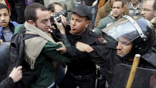 Journalist being challenged by Egyptian Police