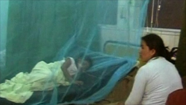 Child with dengue fever in a hospital bed