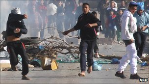 Youths throwing stones in Algiers