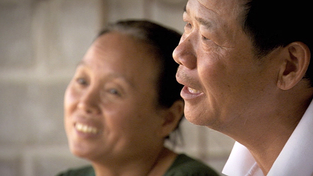 Chinese chicken farmer, Pan Wei Zhi and his wife