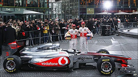 Lewis Hamilton and Jenson Button pose with the new McLaren