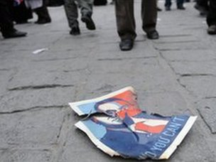 A portrait of President Mubarak is left behind by demonstrators