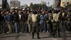 Egyptian soldiers watch as anti-Mubarak protesters approach their barricade to enter Tahrir Square, Cairo - 4 February 2011