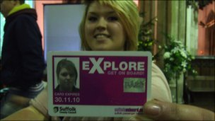 Danielle holding her Explore card