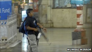 In this Nov. 26, 2008 file photo, a gunman identified by police as Ajmal Qasab walks at the Chatrapathi Sivaji Terminal railway station in Mumbai, India