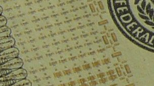 Close up of tagged $5 banknote
