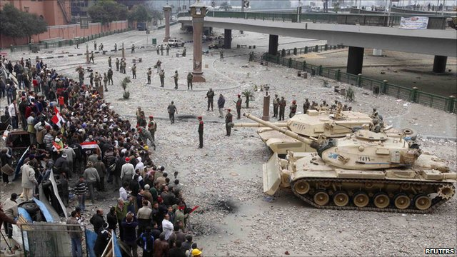 Egyptian army tanks move towards opposition supporters' front lines near Tahrir Square in Cairo February 5, 2011