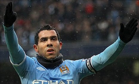 Carlos Tevez celebrates his hat-trick