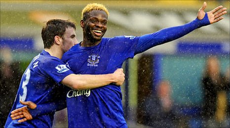 Seamus Coleman (left) congratulates four-goal striker Louis Saha