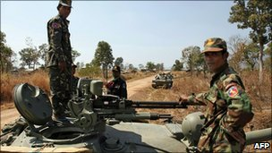 Cambodian soldiers stand on a tank near the Preah Vihear temple in Preah Vihear province, 6 Feb
