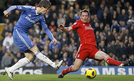 Liverpool centre-back Jamie Carragher (right) blocks a shot from former team-mate and Chelsea striker Fernando Torres