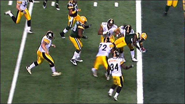 Nick Collins scores an interception for Green Bay