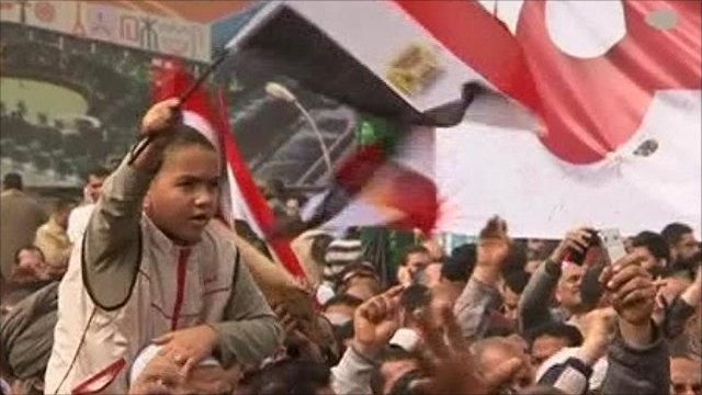 Child with flag in Cairo