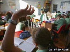 School pupil with arm raised