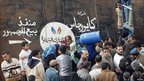 Egyptians stand in front of a gas canister warehouse in Cairo February 6, 2011, as some areas of the country face a gas canister shortage.