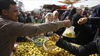 Egyptians shop at a vegetable market in Cairo February 6
