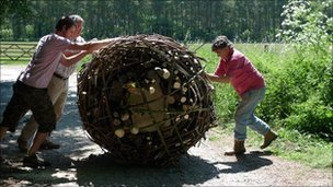 Moving a stone in a wicker construction
