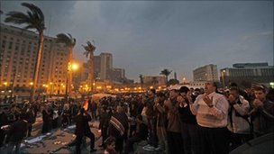 Anti-government protesters pray at dusk in Tahrir Square, Cairo (7 February 2011)