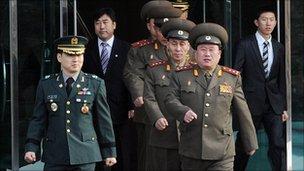 North Korean delegates (R) with South Korean official (L)
