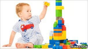 boy building tower