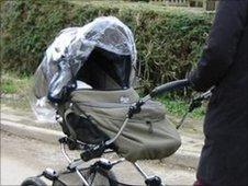Mother and Baby out for a walk pushing pram