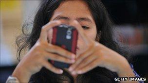 Woman checks her blackberry