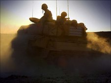 Spartan tank of the British Army during a sunset patrol in southern Iraq