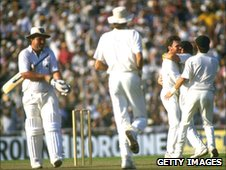 Allan Border is congratulated after taking the wicket of Mike Gatting