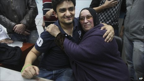 Wael Ghonim embraces the mother of  dead businessman Khaled Said in Tahrir Square, 8 February