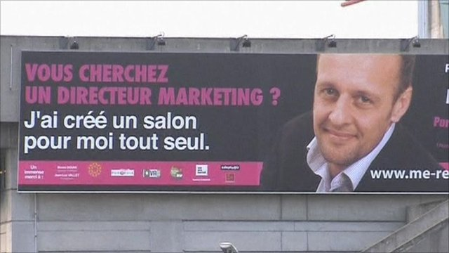 Billboard poster of French businessman Alain Gutton