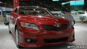 Toyota Camrys are prepared for display at the Chicago Auto Show, 8 February