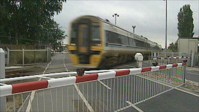 Level crossing with a train passing