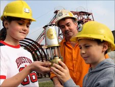 Children with colliery guide Nigel Moore