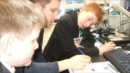 School Reporters Charlie and Harvey work with BBC producer Phil to write a story for the BBC Sport website