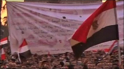 Protesters in Egypt with their national flag