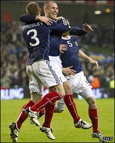 Kenny Miller celebrates opening the scoring
