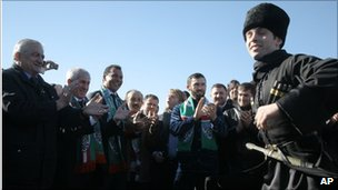 Ruud Gullit (third from left) watches a traditional Chechen dancer perform at Grozny airport, 9 February