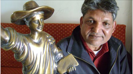Dr Chandra Bhan Prasad with the statue of the English goddess