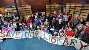 Local residents demonstrate against the potential closure of a library near Milton Keynes